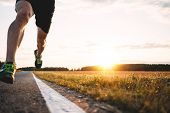 Fast Strong Runner Feet Running On Asphalt Road Close Up In Sport Shoe. Athlet Run Outdoor. Blurred  poster