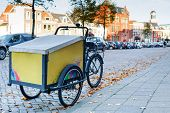 Dutch Yellow Cargo Pedal Tricycle Parked Near Sidewalk On The Street Of Leiden, Netherlands. Histori poster