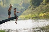 Children Poverty Living In Countryside Vietnam Are Fishing At The River,rural Concept Of Asia poster