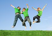Happy Smiling Kids Jumping For Joy