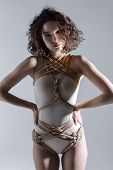 Sexy Cute Beautiful Fashion Brunette Female Woman Adult With Curve Hair Wears Beige Bodysuit And Rop poster
