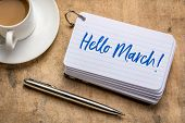 Hello March! Handwriting on a stack of index cards with a cup of coffee and  a pen poster