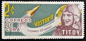 CUBA - CIRCA 1963: A stamp printed in Cuba shows Titov and rocket Vostok 2 circa 1963