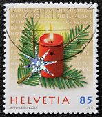 HELVETIA (SWITZERLAND) - CIRCA 2009: A christmas stamp printed in Switzerland shows candle