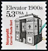 UNITE STATES OF AMERICA - CIRCA 1988: A stamp printed in USA shows Elevator 1900s nonprofit carrier