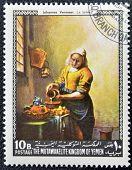 YEMEN - CIRCA 1968: A stamp printed in Yemen shows The Milkmaid by Johannes Vermeer circa 1968