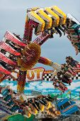 Teens Have Fun On Inverted Carnival Ride