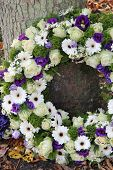 picture of sympathy  - White and purple sympathy flowers in a funeral wreath - JPG