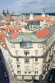 Top View Cityscape On Old Prague District, Tiled Mansard Roofs