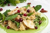foto of pecan nut  - Quinoa pear salad with spinach cranberries and pecan - JPG