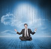Businessman meditating and smiling with matrix