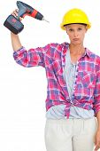 Blonde handy woman holding a power drill on white background