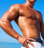 Muscular Brutal Man On The Beach