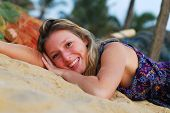 Attractive Blond Girl Laying On Beach