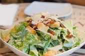 picture of caesar salad  - close up caesar salad on white plate fresh salad for health and delicious food - JPG