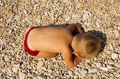 The Little Boy Fell Asleep On The Beach.