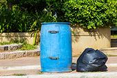 Garbage Bin And Black Bag