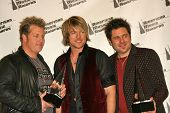 LOS ANGELES - NOVEMBER 21: Gary LeVox,  Joe Don Rooney and Jay DeMarcus (Rascal Flatts) at the 34th