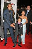 WESTWOOD, CA - DECEMBER 07: Will Smith with Jaden Christopher Syre Smith and Jada Pinkett Smith at the premiere of