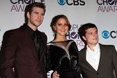Liam Hemsworth, Jennifer Lawrence and Josh Hutcherson at the 2013 People's Choice Awards Press Room,