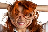 Red-haired Girl Makes Out Of Its Hands Symbolic Glasses