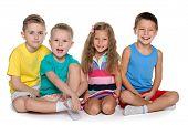 Sitting Four Cheerful Children