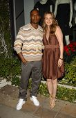Alicia Silverstone and Kanye West at Stella McCartney Holiday Window Lighting to benefit the Kanye W