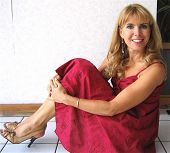 OXFORD - JULY 27: Julia Verdin wearing a dress by Dean Alan, shoes by Carlos Santana and jewelry by