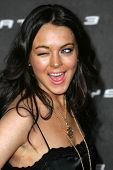 LOS ANGELES - OCTOBER 08: Lindsay Lohan winking at the Playstation 3 Launch Party October 08, 2006 i