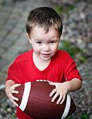 Boy Clutching American Football