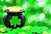 stock photo of pot gold  - St Patricks Day Pot of Gold and shamrocks over a green background - JPG