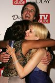 HOLLYWOOD - AUGUST 27: Aisha Tyler, Kevin Nealon and Susan Yeagley at the TV Guide Emmy After Party August 27, 2006 in Social, Hollywood, CA.