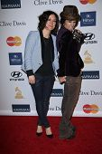 Sara Gilbert, Linda Perry at the 2013 Clive Davis And Recording Academy Pre-Grammy Gala, Beverly Hil