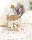 Shabby background with bottle,crochet doily and hand fan