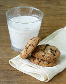 delicious homemade cookies with chocolate chips on a wooden table