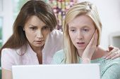 stock photo of bullying  - Mother Comforting Daughter Victimized By Online Bullying