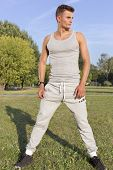 Full length of determined jogger standing in park