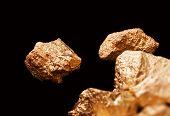 Gold Nuggets On Black Background.