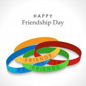 Friendship bands on grey background for Happy Friendship Day celebrations.