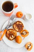 stock photo of loquat  - Cottage cheese pancakes and fresh loquat for breakfast - JPG