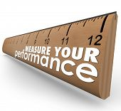 pic of benchmarking  - Measure Your Performance words on a wooden ruler - JPG