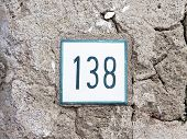 Number 138 On Old Wall