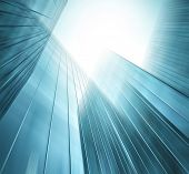 Abstract illustration background texture of perspective wide angle view to steel light blue glass surface, high rise building skyscraper commercial modern city of future Business industry architecture