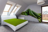 stock photo of attic  - Horizontal view of luxury bedroom in the attic - JPG