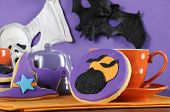 Happy Halloween Party Trick Or Treat Purple And Orange Cookies With Pumpkin And Flying Bats Decorati
