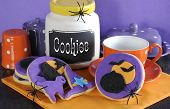 Happy Halloween Party Trick Or Treat Purple And Orange Cookies With Spiders And Cookie Jar.
