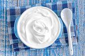foto of yogurt  - Fresh yogurt in a bowl on a table - JPG