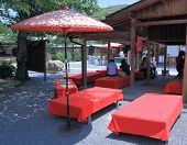 Traditional Japanese street Kiosk with red bench and umbrella