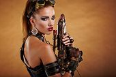 Steampunk woman over gunge background. . Fantasy fashion for cover.