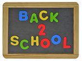 Back to school written on childs slate